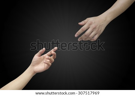 helping hand and hands praying on black backgrounds. helping hand concept.hand of god giving the power to human's hand.abstract religious concept - stock photo
