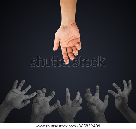 helping hand and hands praying on black color background, concept caring, strength together, assistance and support, hell, heaven - stock photo