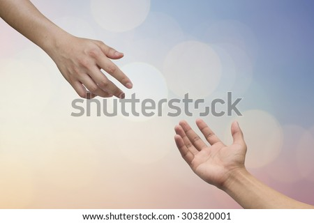 helping hand and hands praying on blurred beautiful twilight sky backgrounds with circle light. helping hand concept.hand of god giving the power to human's hand.  - stock photo