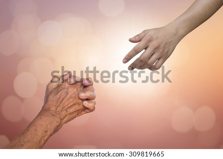 helping hand and hands praying on blurred colorful background : human hands praying and god hand are blessing, helping hand concept. - stock photo
