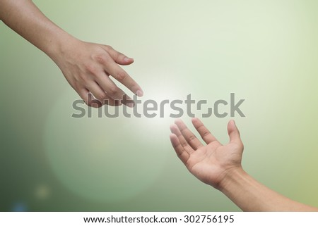helping hand and hands praying on blurred nature background , helping hand concept.hand of power concept. - stock photo
