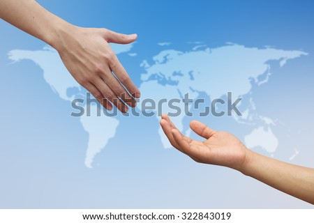 helping hand and hands praying over blur map of the world on blurred blue sky backgrounds. helping hand concept.international assistance concept.business concept.peaceful concept. - stock photo