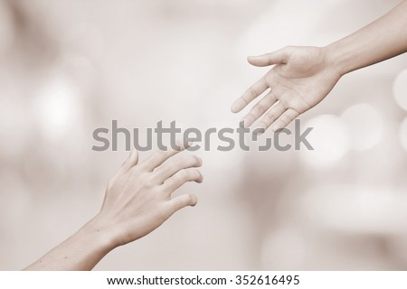 helping hand and hands praying.supporting of humanity conceptual.giving power concept:friends and family relationship,encouragement:abstract healing and assistance hands in vintage tone color concept. - stock photo