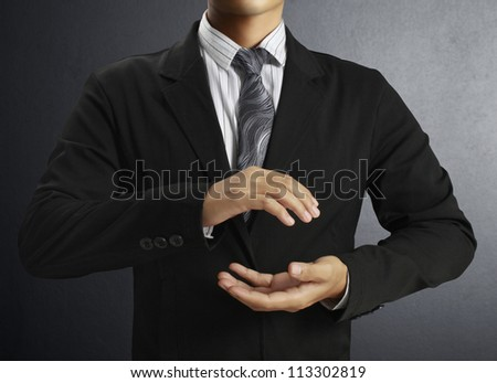 Helping hand Businessman - stock photo