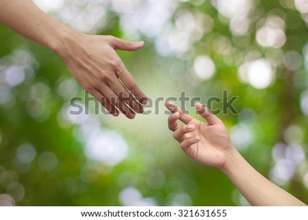 helping hand/hands pray on blurred green nature background:blessing for support each others:assistant support healing:friend encourage cheerful togetherness concept idea.world cancer day:better living - stock photo