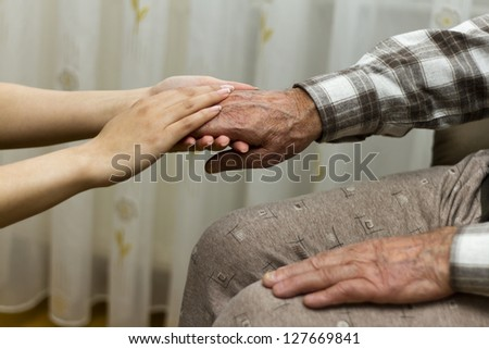 helping hand of daughter to grandfather - stock photo