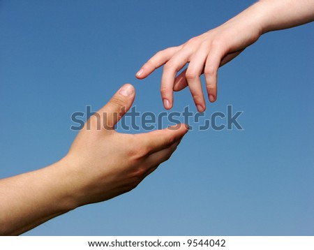Helping Hand with the Sky Background - stock photo