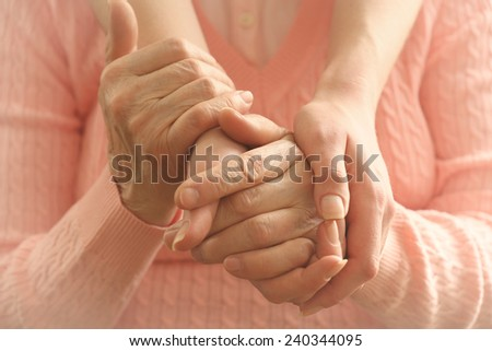 Helping hands, care for the elderly concept - stock photo