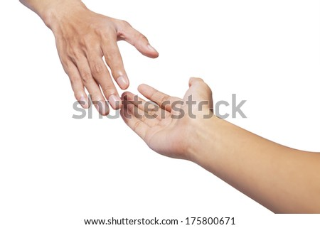 Helping hands, male hand takes young female hand - stock photo