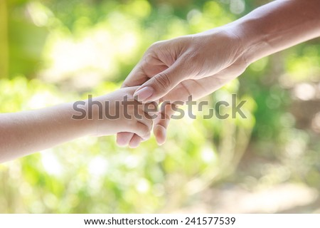 Helping hands  - man holding child hand with love