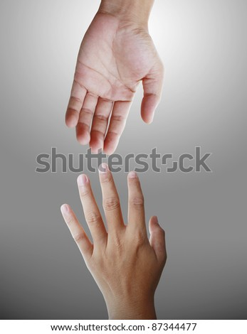 helping hands on a gray background - stock photo