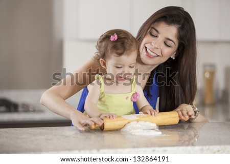 Helping mom cook dinner - stock photo