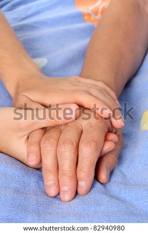 Helping the senior holding patient hand - stock photo
