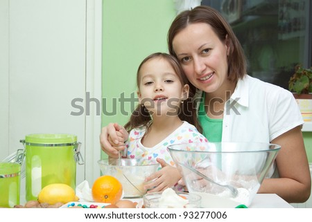 helping to momy in the kitchen - stock photo