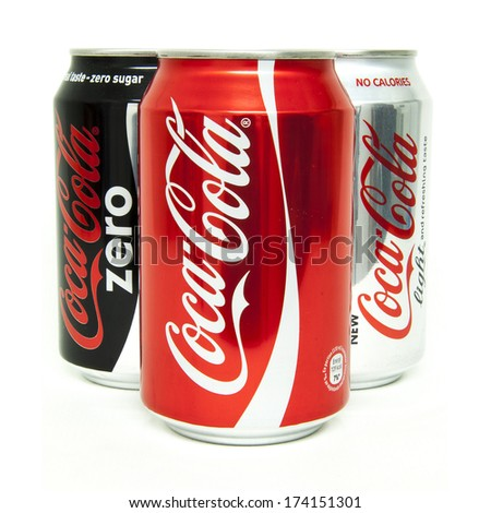 HELSINGBORG, SWEDEN - January 21, 2014: 0,33l Coca-Cola cans Isolated On White Background. Coca-Cola is a carbonated soft drink sold in shops, restaurants, and vending machines around the globe. - stock photo