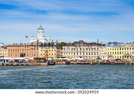 Helsinki cityscape. Central quay, building facades and dome of the main city cathedral on a background - stock photo