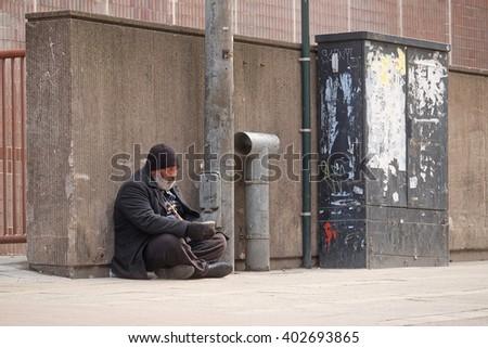 Helsinki, Finland - April, 4, 2016: homeless person in a center of Helsinki, Finland. - stock photo