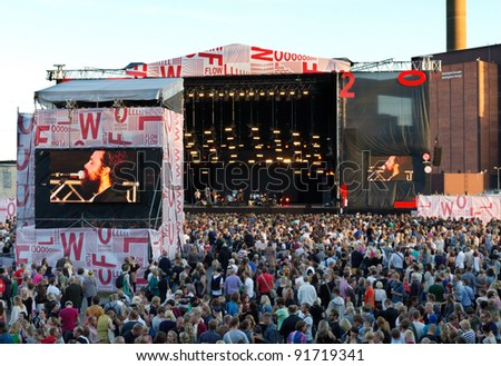HELSINKI, FINLAND - AUGUST 13: American singer-songwriter Iron & Wine performs live on stage August 13, 2011 at Flow 2011 Festival in Helsinki, Finland. - stock photo