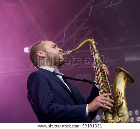 HELSINKI,FINLAND-AUGUST 14:Finnish saxophonist Timo Lassy and his extended orchestra and American star vocalist Jose James live on stage at Flow 2010 Festival on August 14, 2010 in Helsinki, Finland - stock photo