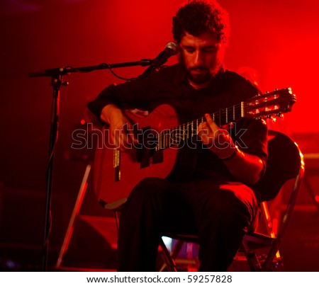 HELSINKI,FINLAND-AUGUST 14: Swedish band Junip fronted by guitarist and singer José González live on stage at Flow 2010 Festival on August 14, 2010 in Helsinki, Finland