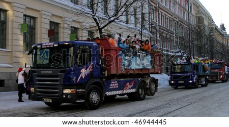 "HELSINKI,FINLAND - FEBRUARY 18:  ""Penkkarit"" event is celebrated in upper secondary school's final day, driving in a parade of decorated lorries throwing candies on February 18, 2010 in Helsinki, Finland"