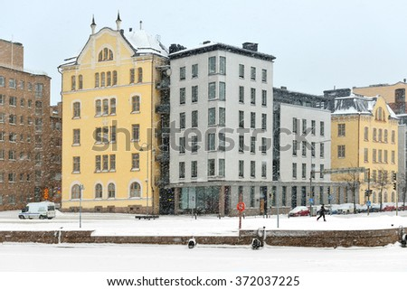 HELSINKI, FINLAND - JAN 10, 2016:Snowfall and blizzard in Helsinki. North Harbour and houses are hardly visible through snowfall veil