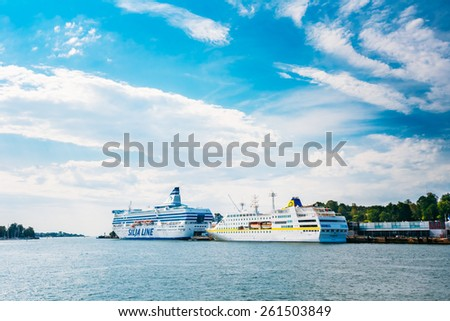 HELSINKI, FINLAND - JULY 28, 2014: Modern passenger ferry boats stays in the seaport. Silja Line of regular flights between Helsinki and Stockholm
