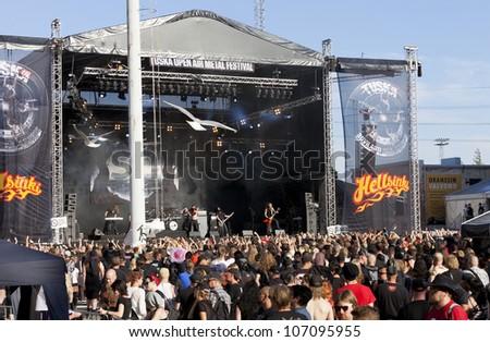 HELSINKI, FINLAND - JULY 01: Unidentified Fans at gig of finnish folk metal band Finntroll July 01, 2012 at 15th annual Tuska Open Air Metal Festival in Suvilahti, in Helsinki, Finland. - stock photo
