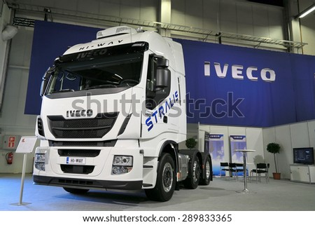 HELSINKI, FINLAND - JUNE 11, 2015:  Iveco Finland Oy presents Iveco Stralis Hi-Way 480hp Euro 6 truck tractor at Logistics Transport 2015. - stock photo