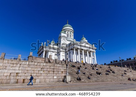 HELSINKI, FINLAND - MAY 3, 2016: Helsinki Cathedral is the Finnish Evangelical Lutheran cathedral of the Diocese of Helsinki. The Facade Fronted By A Statue Of Emperor Alexander II Of Russia