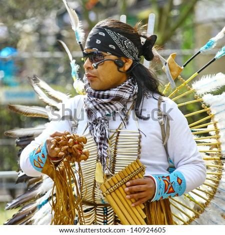 HELSINKI, FINLAND - MAY 1: Native American Indian tribal group play music and sing in the street for tourists and city dwellers on May 1, 2011 in Helsinki, Finland - stock photo
