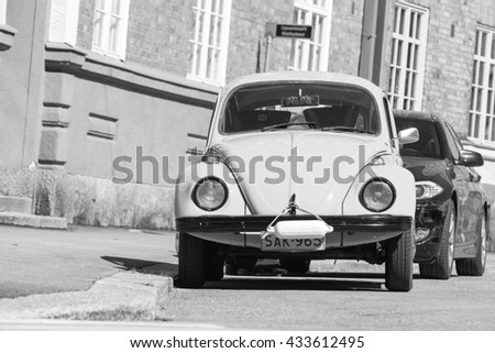 Helsinki, Finland - May 7, 2016: Old yellow Volkswagen beetle, front view, black and white - stock photo