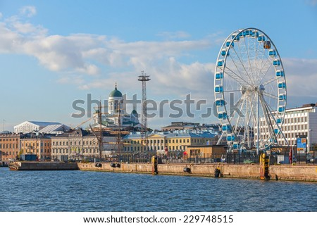 Helsinki, Finland - September 13, 2014: central quay of Helsinki with moored ships, central Cathedral and ferris wheel - stock photo