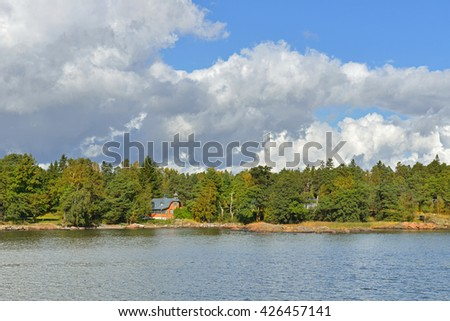 HELSINKI, FINLAND - SEPTEMBER 26, 2015: Helsinki shoreline is adorned by around 100 km of coast and over 300 islands of which many are accessible for recreational use. House on bank