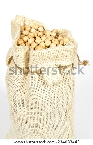 Hemp bag filled with chickpeas on a white background - stock photo
