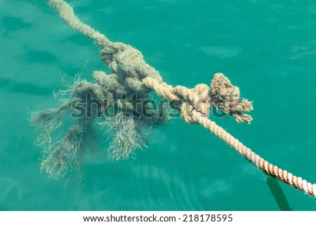 Hemp rope in the sea - stock photo