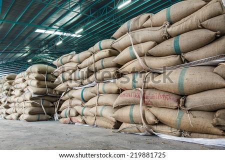 hemp sacks containing rice - stock photo