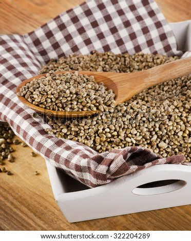 Hemp seeds on a wooden background. Selective focus - stock photo