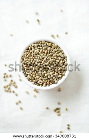 hemp seeds on wooden surface