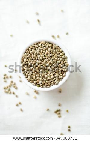 hemp seeds on wooden surface - stock photo
