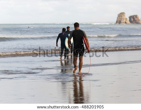 HENDAIA,FRANCE-SEPTEMBER 18,2016: Surfer practicing surfing on the beach of Hendaia on September 18, Hendaia,France.