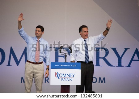 HENDERSON, NV - OCTOBER 23: Mitt Romney and Paul Ryan on stage at Presidential campaign rally at Henderson Pavilion on October 23, 2012 in Henderson, Nevada - stock photo