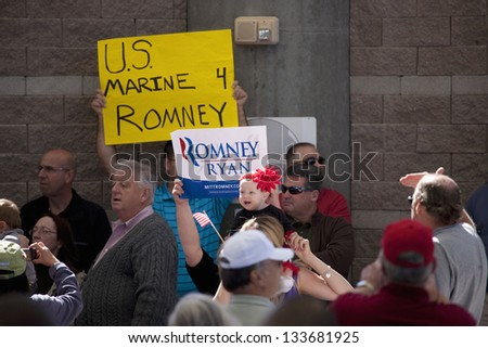 HENDERSON, NV - OCTOBER 23: Supporters with signs for Governor Mitt Romney on a Presidential Campaign rally on October 23, 2012 at Henderson Pavilion in Henderson, NV