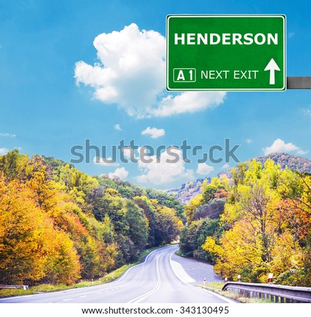 HENDERSON road sign against clear blue sky - stock photo