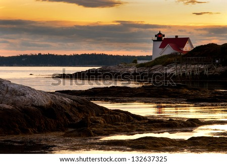 "Hendricks Head Lighthouse in Maine's Boothbay region, is known for a famous baby rescue and a woman who haunts the area before sunset known as the ""Lady of the Dusk."" - stock photo"