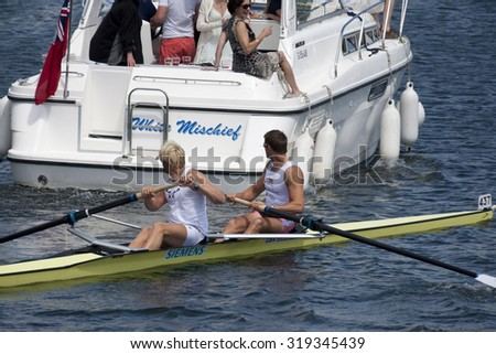 HENLEY, ENGLAND. 04-07-2010.  P.K. Reed & A. Triggs Hodge almost collide with a powered vessel on their way to the start on day 5 of the Henley Royal Regatta 2010 held on the River Thames.   - stock photo