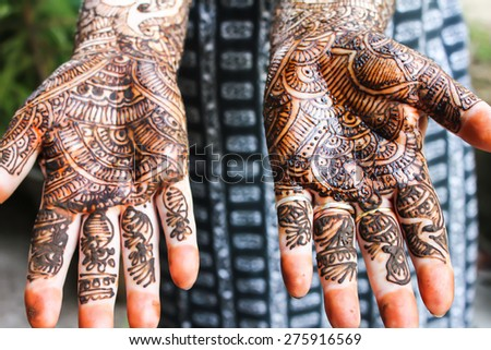 Henna is applied to the hands of a Hindu Bride