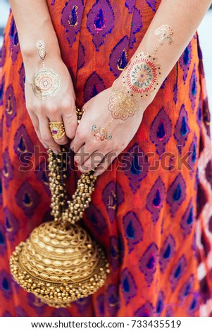 Henna Tattoo On Both Hands And Arms For Woman At Indian Wedding Ceremony In Bangkok