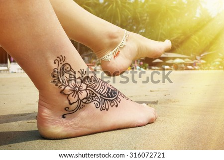 Henna tattoo on the foot. Palolem beach of South Goa, India - stock photo