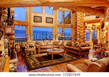 Henry's Lake, Idaho, USA Jul. 28, 2011 The interior of a residential log cabin in the mountains. The cabin is constructed with Eastern red cedar, giving a warm colored light to the interior. - stock photo